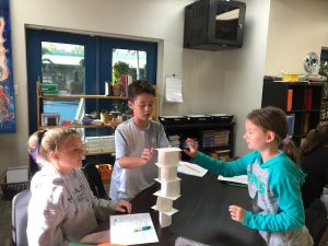 Kids making card tower